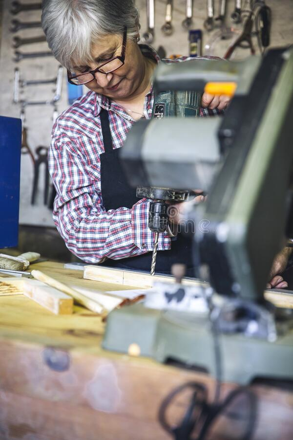 Senior woman in a carpentry royalty free stock photography