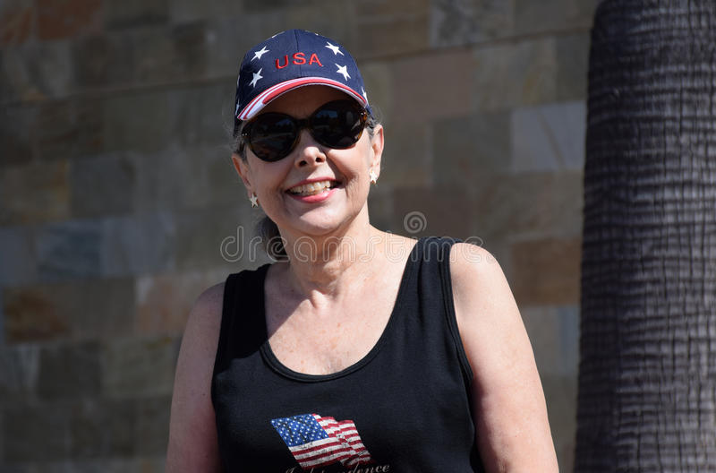 Senior woman celebrating Independence Day. Image shows a senior woman dressed up to celebrate USA Independence Day (July 4th stock photography