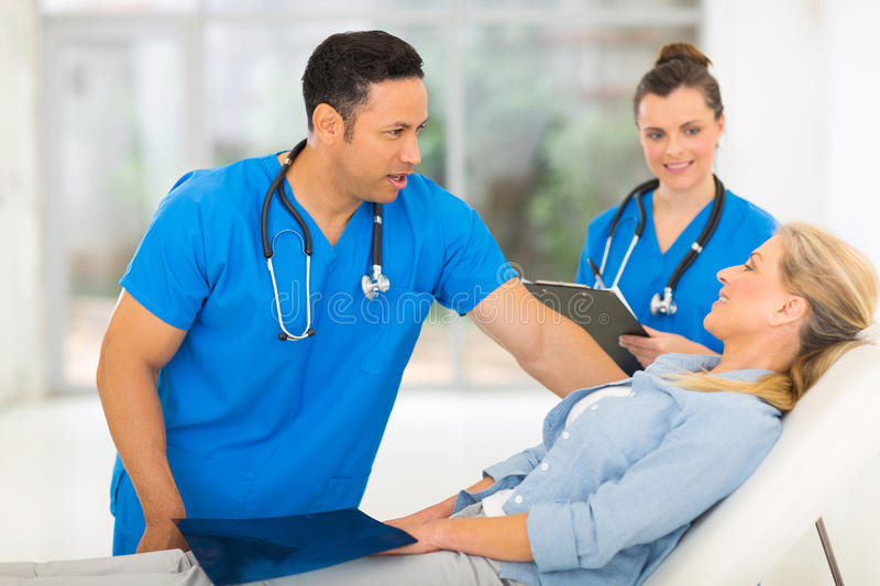 Senior woman check up. Beautiful senior women in doctor's office for check up stock photo