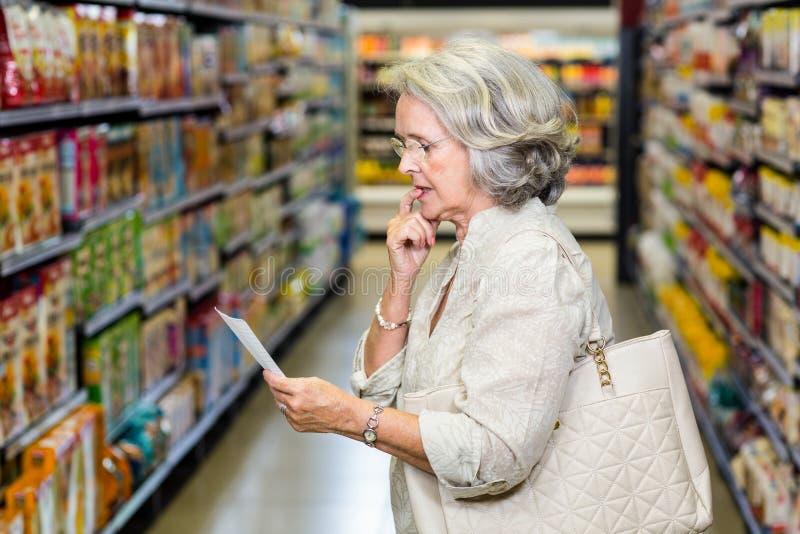 Senior woman checking list royalty free stock photography