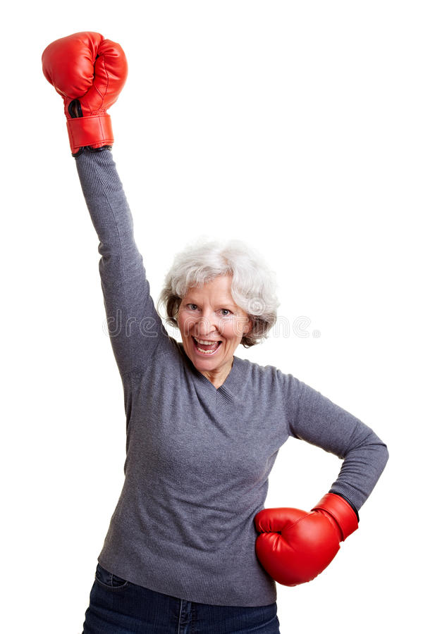 Senior woman cheering with boxing stock photography