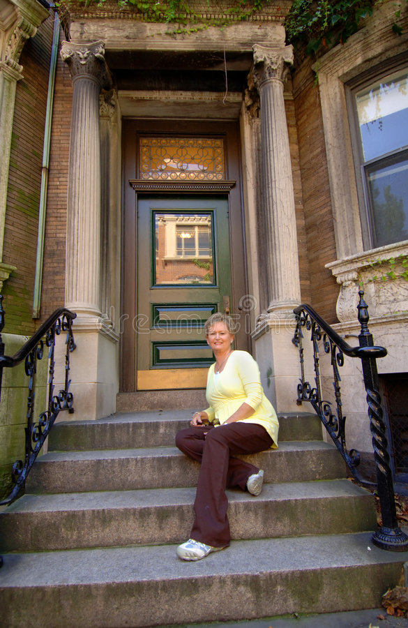 Download Senior Woman On City Apartment Steps Stock Photo - Image of residence, apartment: 6345900