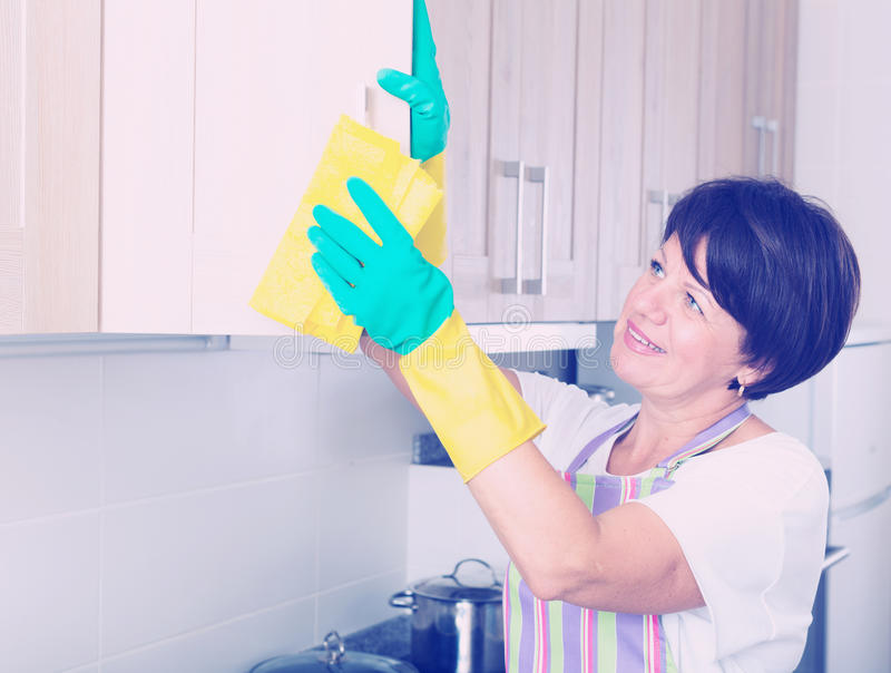 Download Senior woman cleaning stock photo. Image of lifestyle - 83701612