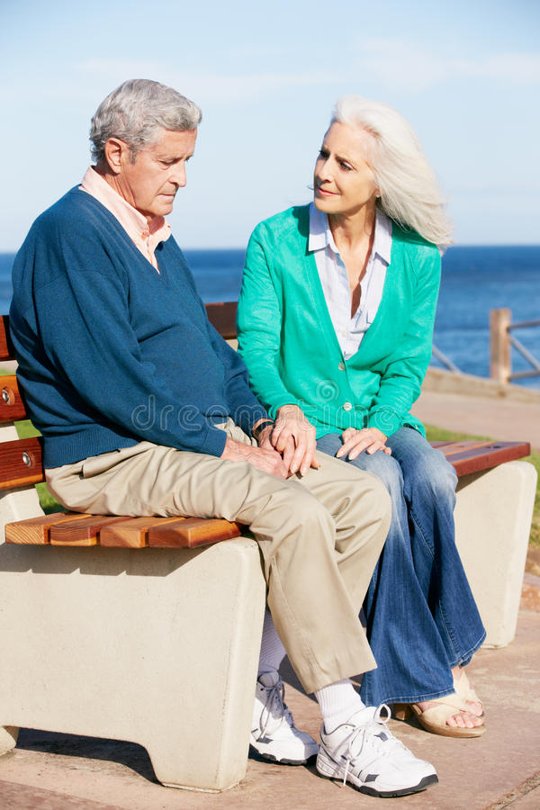 Download Senior Woman Comforting Depressed Husband Stock Photo - Image: 27957090