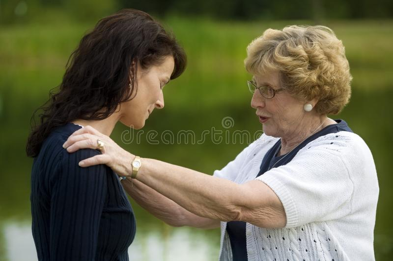 Senior Woman Consoling Her Daughter Royalty Free Stock Photos