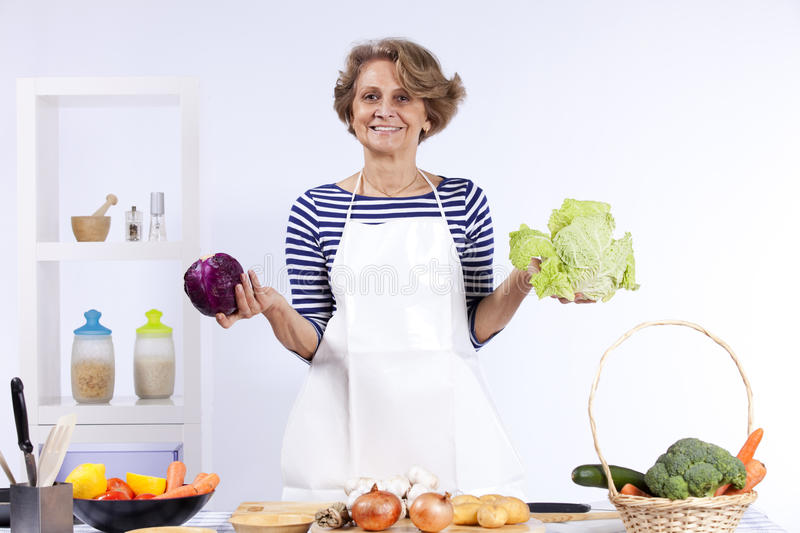 Download Senior woman cooking stock image. Image of broccoli, happy - 19689749