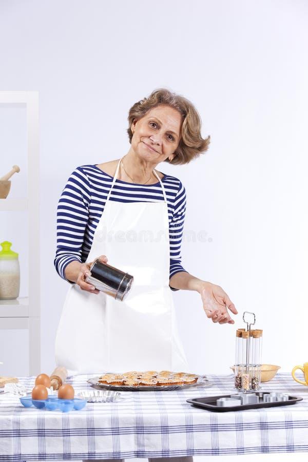 Download Senior woman cooking stock image. Image of gourmet, indoors - 19781325