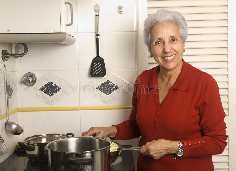 Download Senior woman cooking stock image. Image of home, food - 4169403