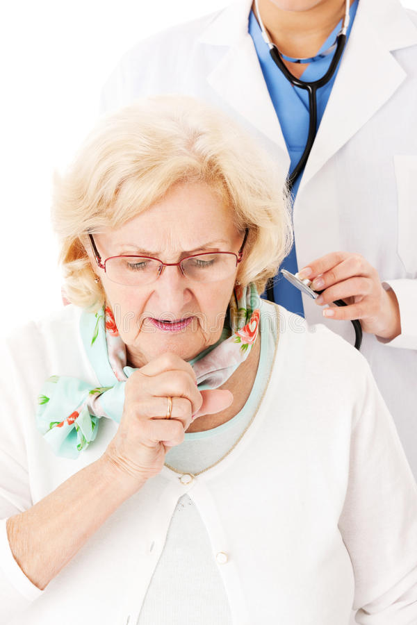 Senior Woman Coughing While Doctor Examining Her. Senior women coughing while female doctor examining her over white background royalty free stock photo