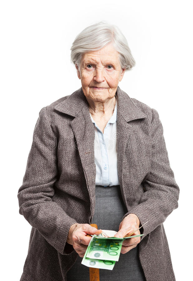 Senior woman counting money on white background stock images