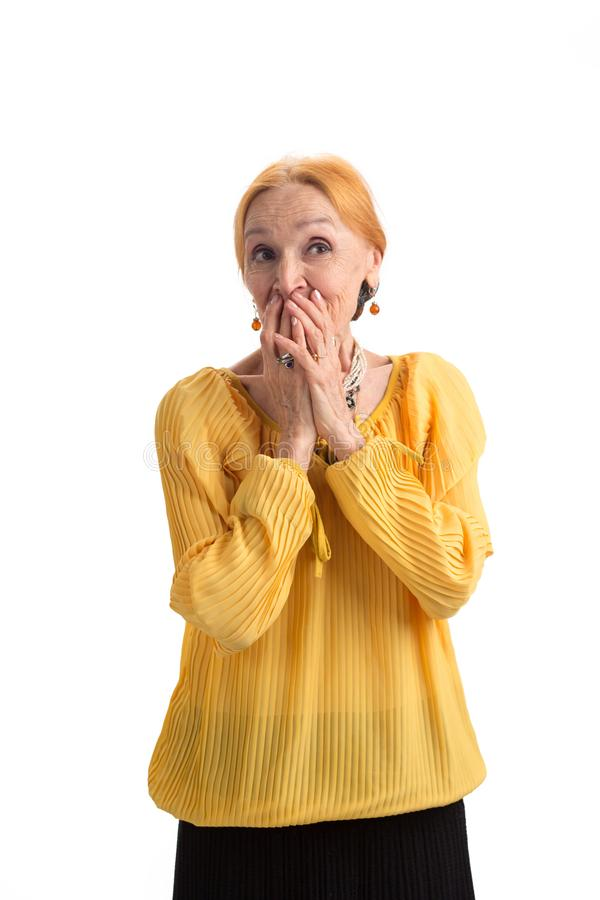 Senior woman covering mouth. royalty free stock photos