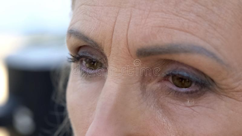 Senior woman crying, praying for peace, war victim, depression and apathy stock photos