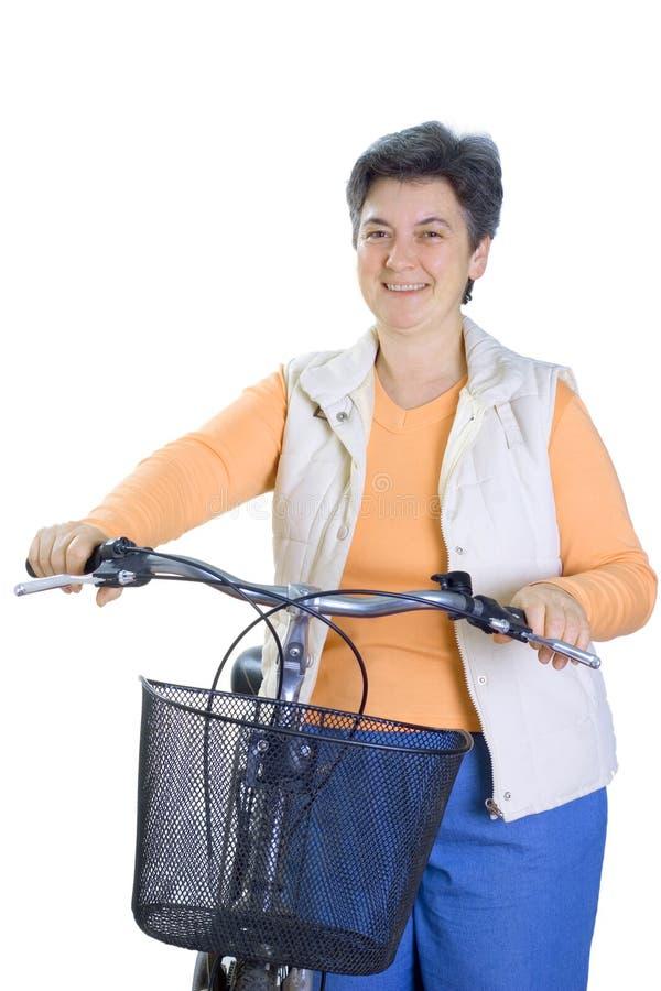 Senior woman on cycle royalty free stock photo