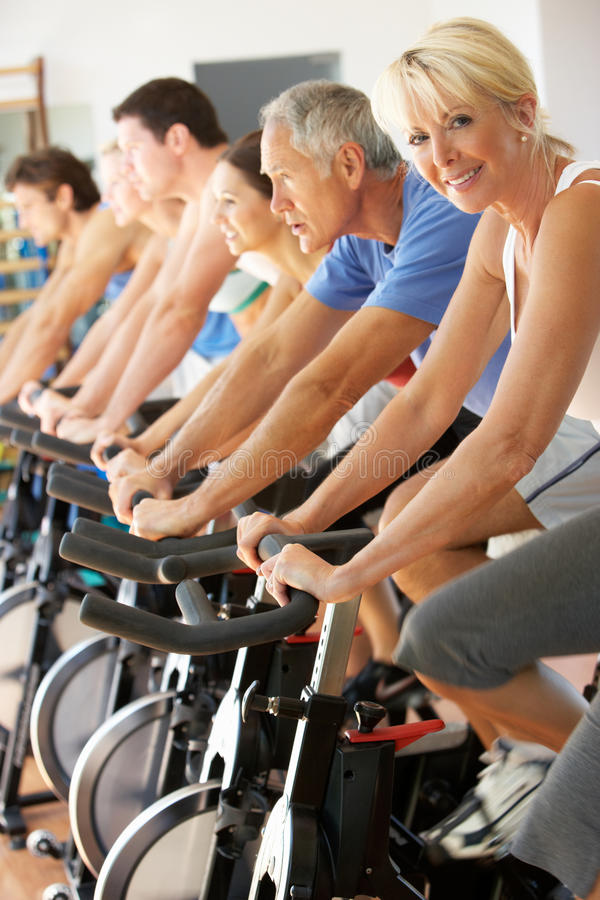 Senior Woman Cycling In Spinning Class stock photography