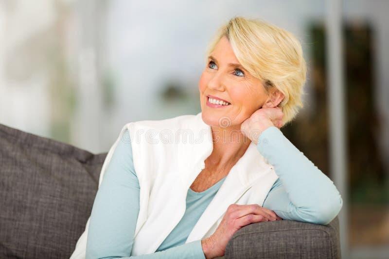 Senior woman daydreaming royalty free stock photos