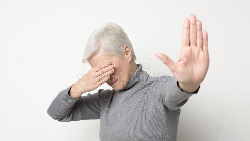 Senior woman denying proposal, making stop gesture with her hand. Panorama royalty free stock images