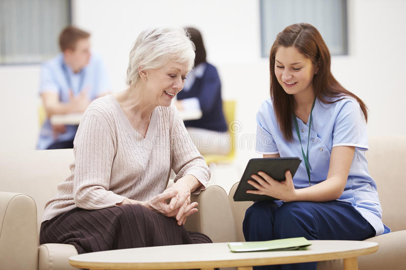 Senior Woman Discussing Test Results With Nurse royalty free stock image