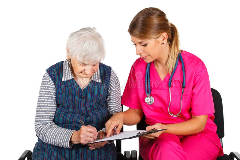 Senior woman at the doctor stock image