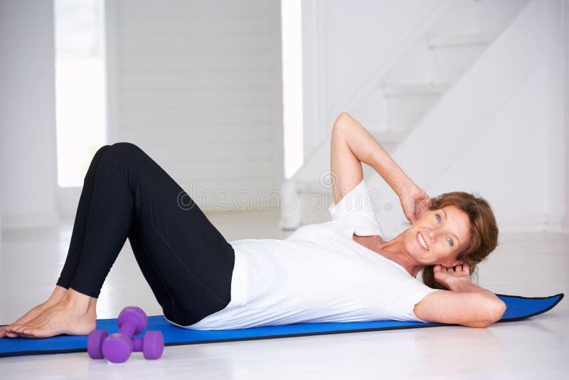 Download Senior Woman Doing Curl-ups Stock Image - Image: 21274773