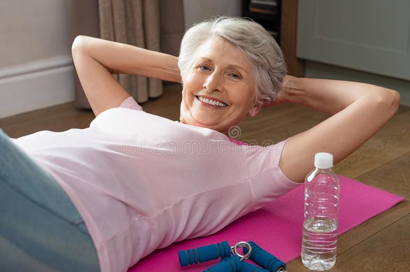 Senior woman doing crunches stock photo