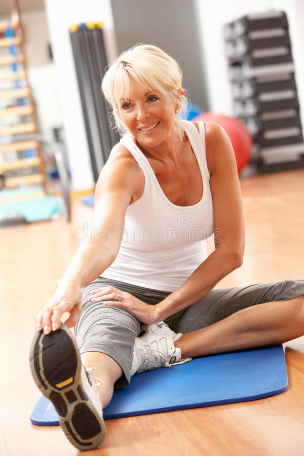 Senior Woman Doing Stretching Exercises stock photography