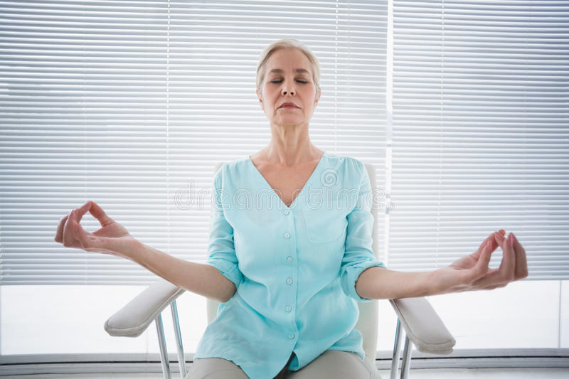 Senior woman doing yoga royalty free stock images