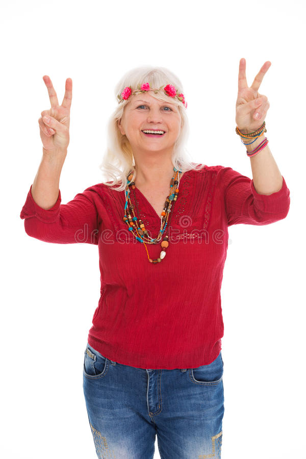 Senior woman dressed like a hippie royalty free stock images