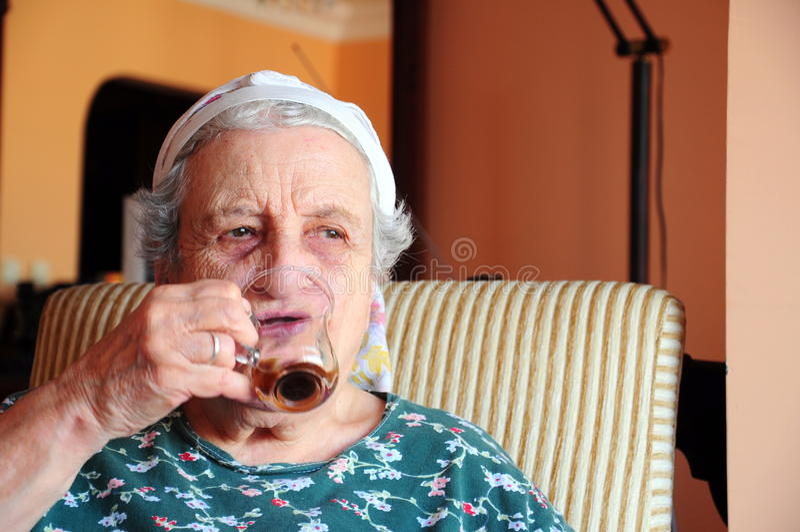 Download Senior woman drinking stock image. Image of hand, elegant - 21194639