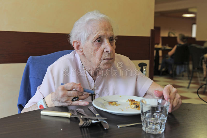 Download Senior woman eating stock image. Image of woman, process - 18274129