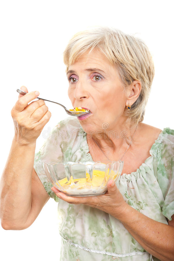 Senior Woman Eating Cereals Royalty Free Stock Photo