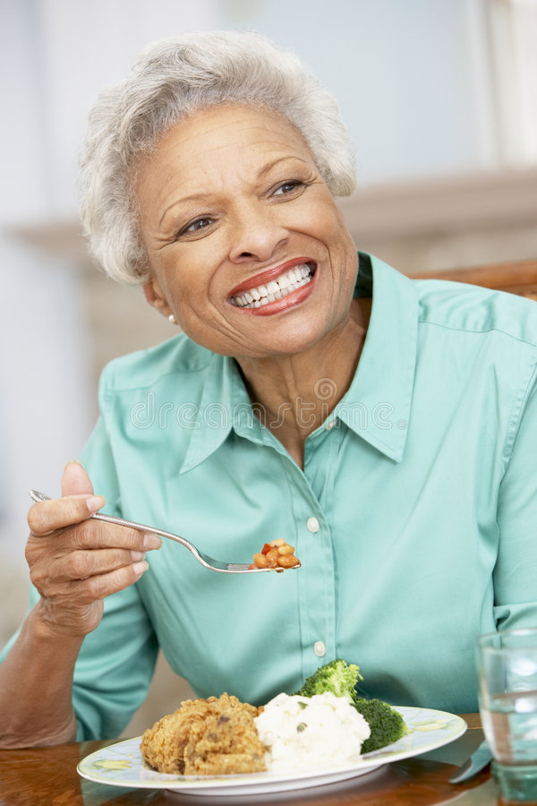 Download Senior Woman Enjoying A Meal At Home Stock Photo - Image: 8754746
