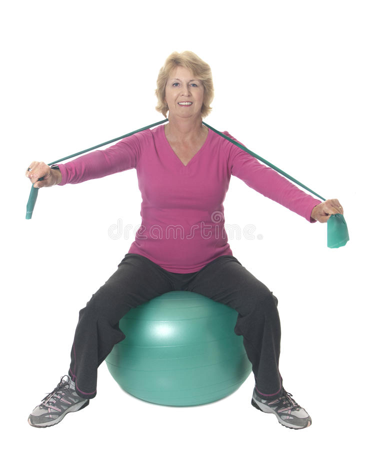 Download Senior Woman On Exercise Ball With Resistance Band Stock Image - Image of ball, arms: 15431913