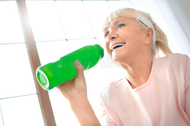 Senior woman exercise at home health care drinking water process stock images