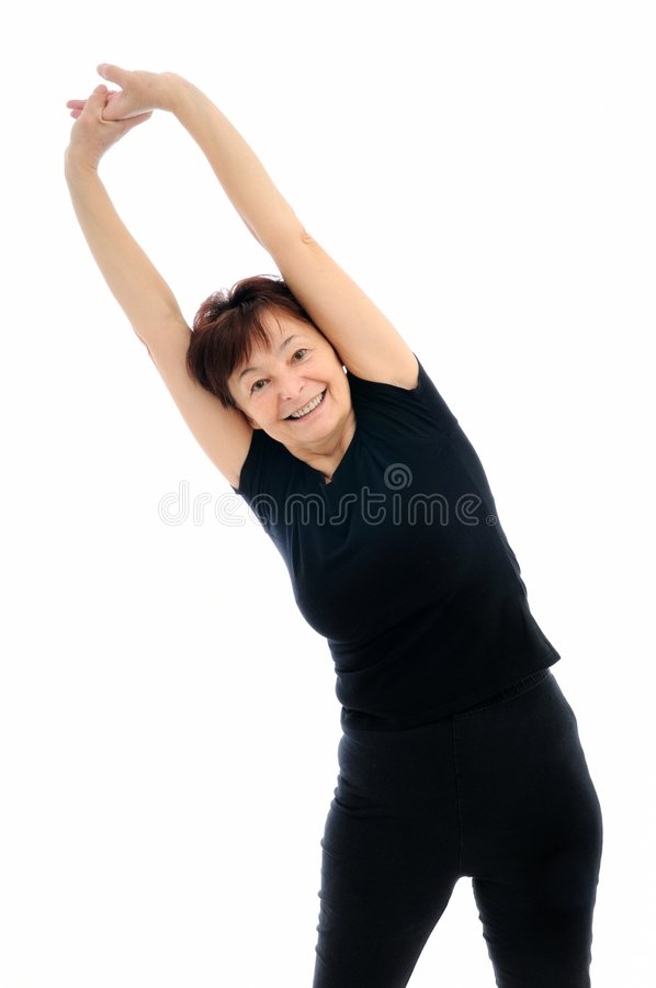 Senior woman exercises stock photo