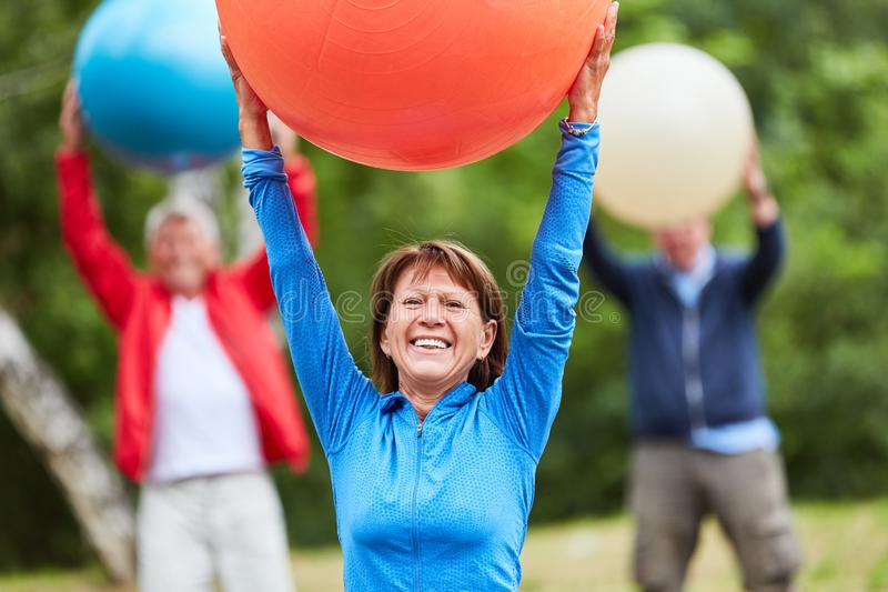 Senior woman exercises fitness with gym ball royalty free stock photography