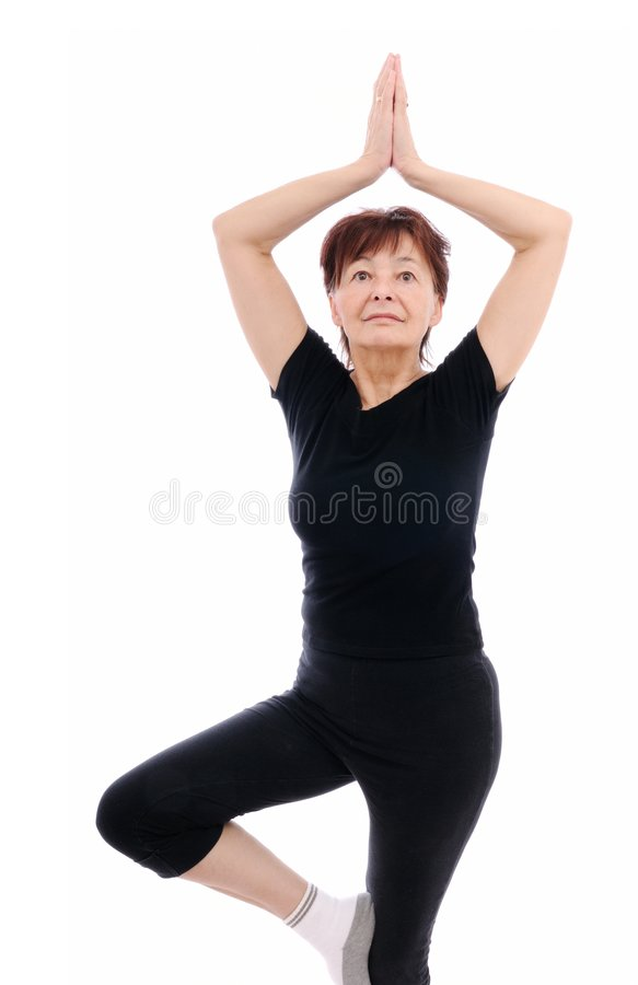 Senior woman exercises yoga royalty free stock image