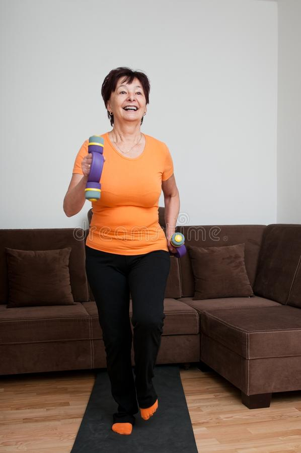 Download Senior Woman Exercising With Barbells Stock Photo - Image: 22658998