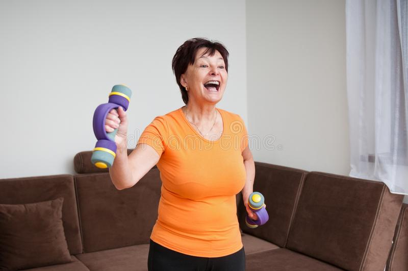 Senior woman exercising with barbells