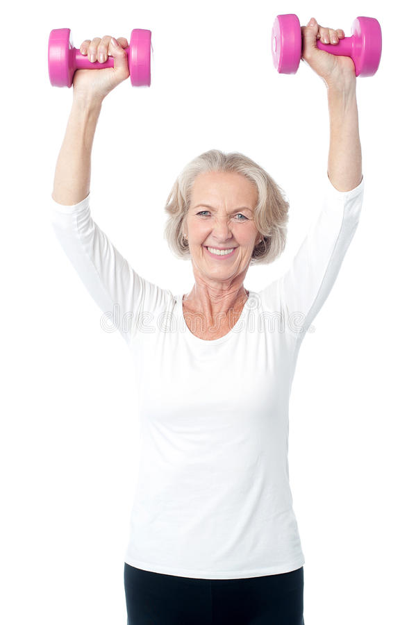 Senior woman exercising with dumbbells royalty free stock images