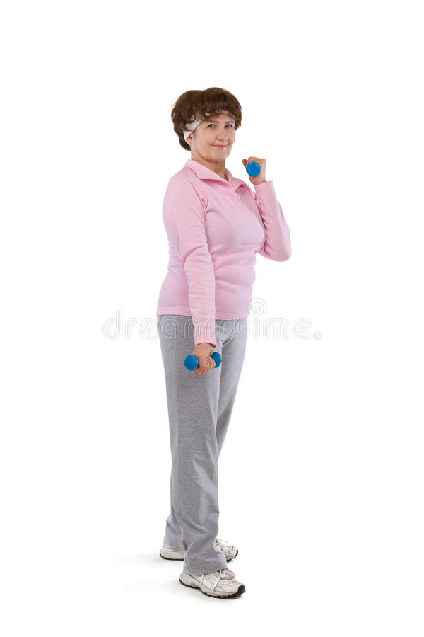 Senior woman exercising with dumbells royalty free stock photo
