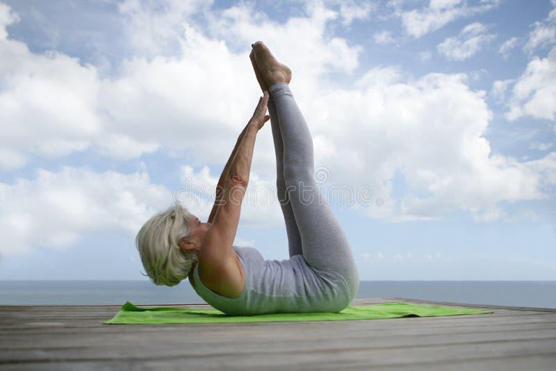 Senior woman exercising outside stock photos