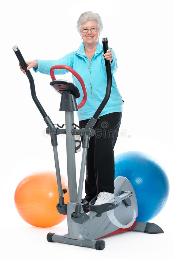 Download Senior Woman Exercising On Stepper Stock Photo - Image: 24356698