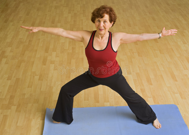 Download Senior Woman Exercising Yoga Stock Photo - Image: 8973836