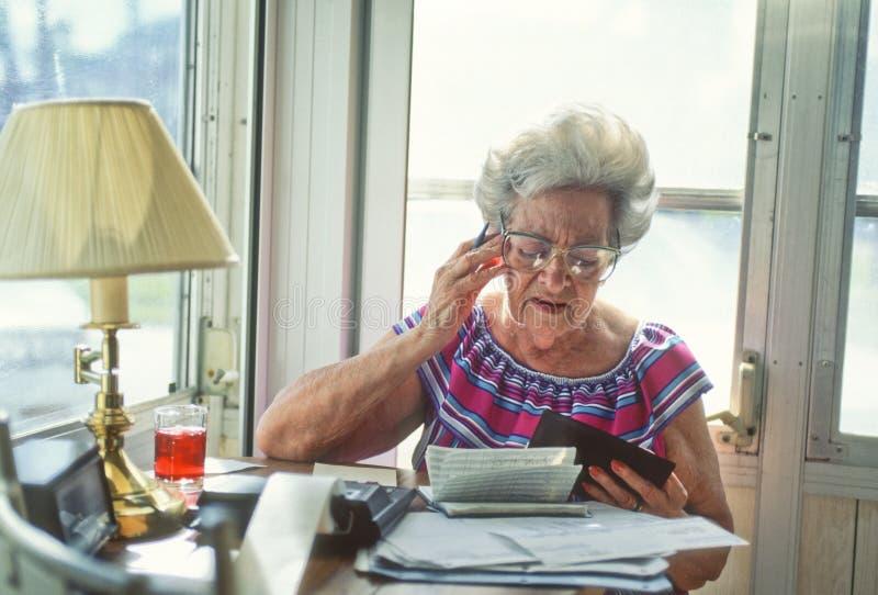 Senior woman with finances_2 stock photo