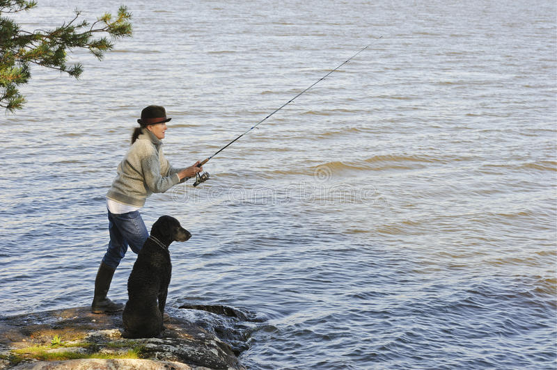 Senior woman fishing royalty free stock photos