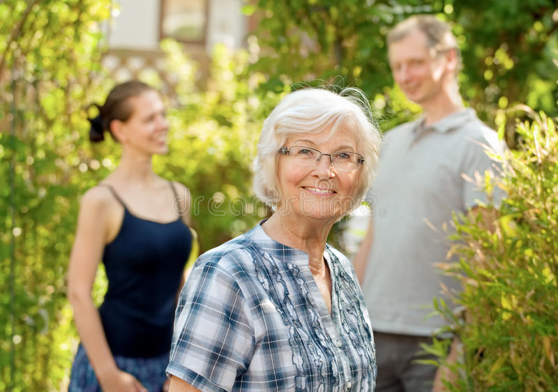 Senior woman in front of a young couple royalty free stock photo