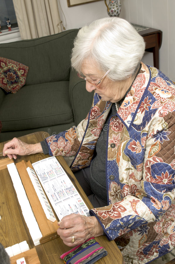 Download Senior Woman At The Game Table Stock Photography - Image: 1711982