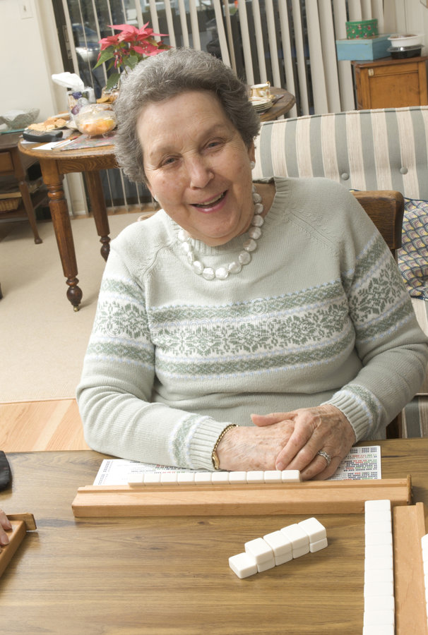 Download Senior Woman At The Game Table Stock Photo - Image: 1712004