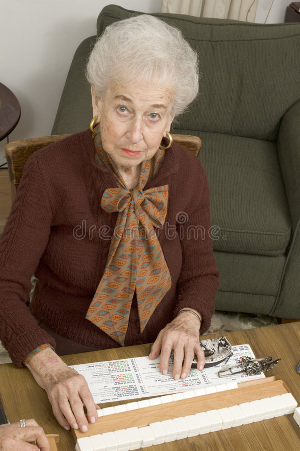 Download Senior Woman At The Game Table Stock Images - Image: 1713134