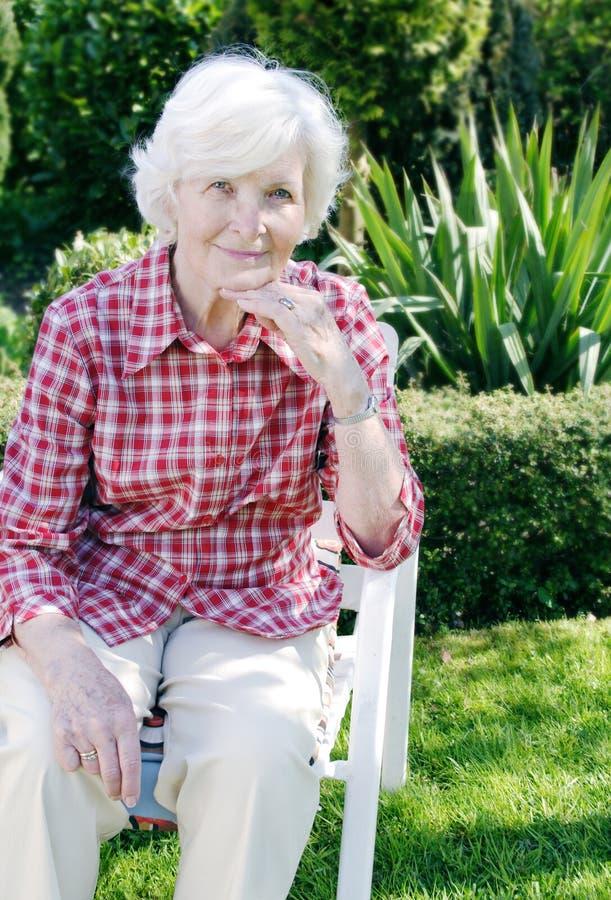 Senior woman in the garden stock image